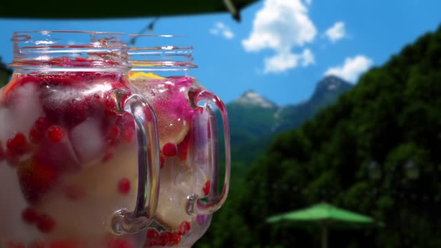 Fruit drinks on the mountain background