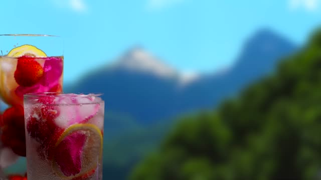 fruit drinks on the mountain background - currant stock videos & royalty-free footage
