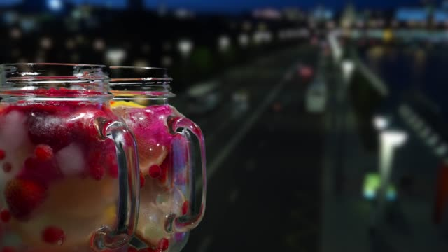 fruit drinks on the night street background - currant stock videos & royalty-free footage
