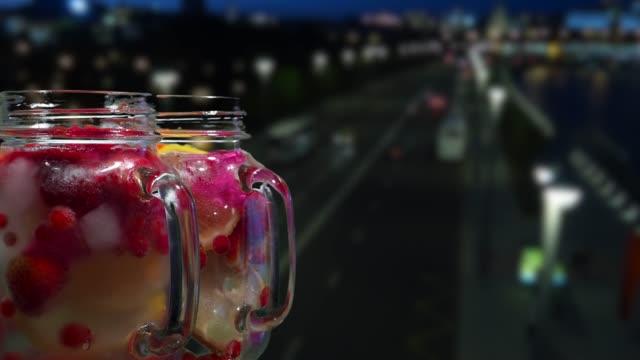 Fruit drinks on the night street background
