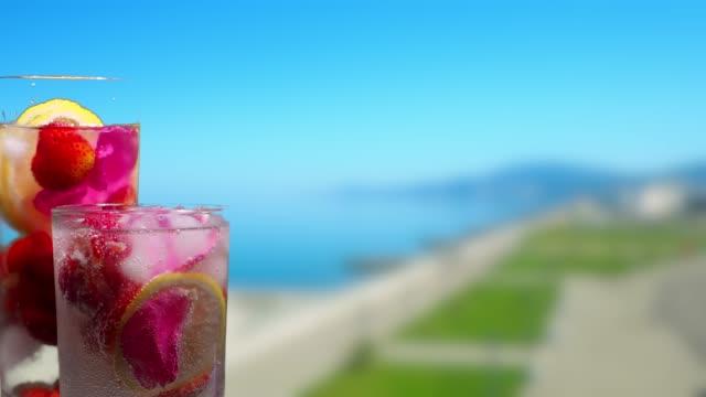 Fruit drinks on the resort embankment background