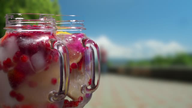 Fruit drinks on the resort street background
