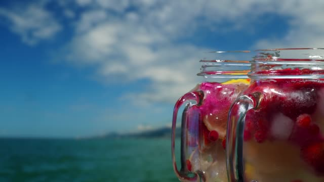 Fruit drinks on the sea background