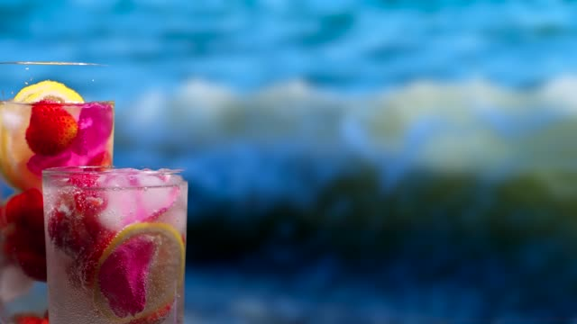 fruit drinks on the sea background - currant stock videos & royalty-free footage