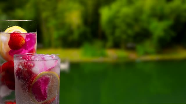 fruit drinks on the summer park background - currant stock videos & royalty-free footage