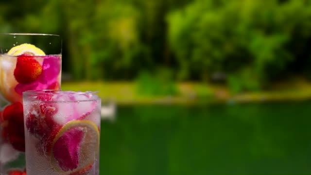 Fruit drinks on the summer park background