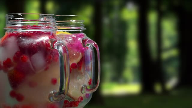 fruit drinks on the tropical park background - currant stock videos & royalty-free footage