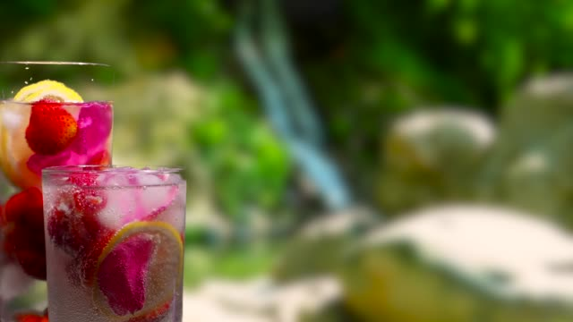 Fruit drinks on the waterfall background