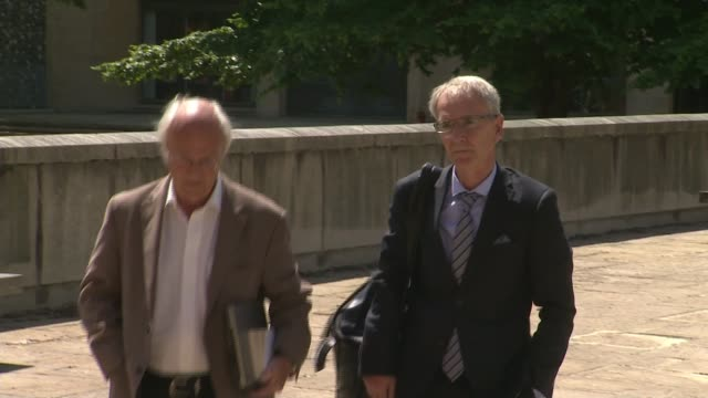 fruit farm manager found guilty of manslaughter england hampshire winchester corwn court ext andrew stocker arriving at court with unidentified man - hampshire stock-videos und b-roll-filmmaterial