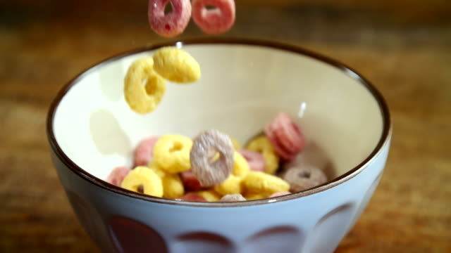 fruit loops falling into bowl - bowl stock videos & royalty-free footage