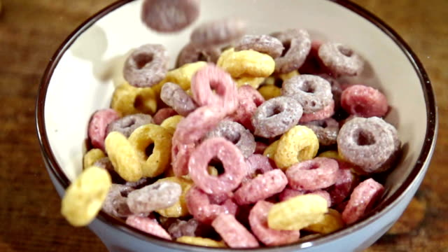 fruit loops falling into bowl - breakfast cereal stock videos and b-roll footage