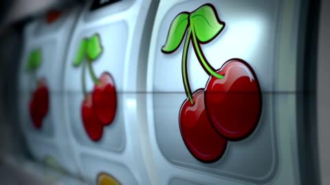 fruit machine: close up: cherries win - gambling stock videos & royalty-free footage