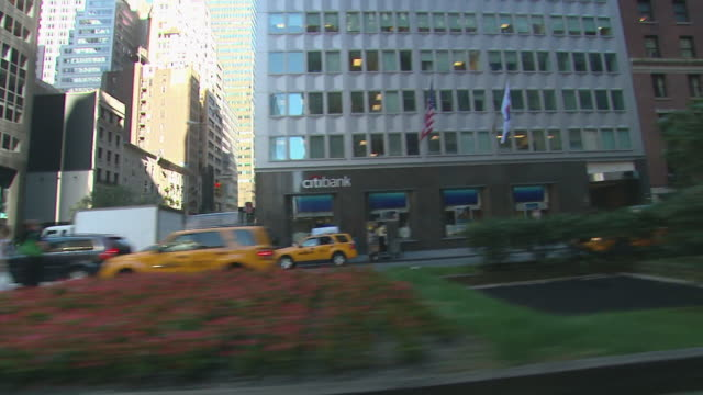 R/F Fruit Stand driving footage down Park Avenue PAN of generic NYC skyscrapers