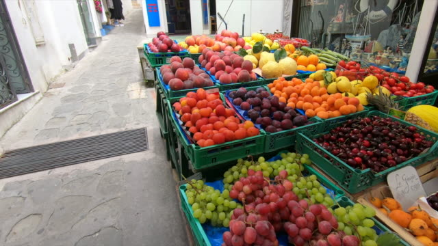 fruit stand with grapes, cherries, plums in capri island, italy, europe. - slow motion - multi coloured stock videos & royalty-free footage