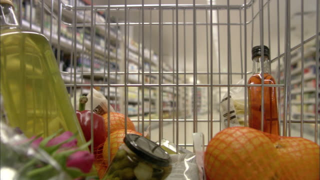 cu pov fruits and bottles in shopping trolley moving through supermarket isle / north finchley, london, uk - trolley stock videos and b-roll footage