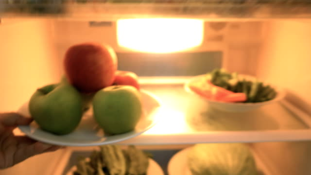pov : fruits and vegetables in the refrigerator. - mela video stock e b–roll