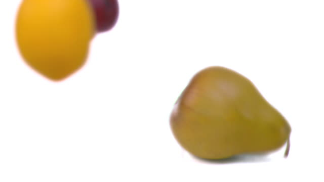 Fruits falling in super slow motion