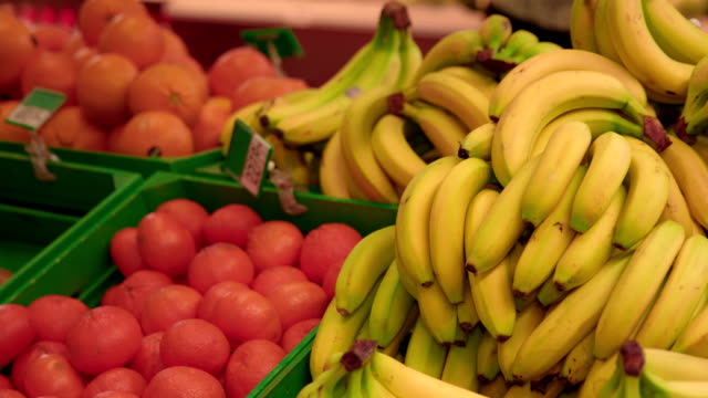 fruits in super market - banana stock videos & royalty-free footage