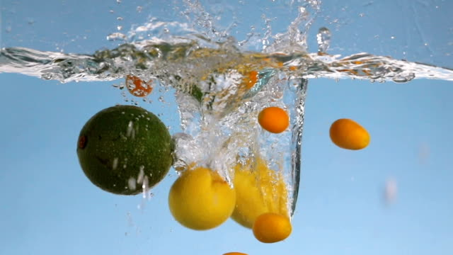 fruits splashing into water - small group of objects stock videos & royalty-free footage