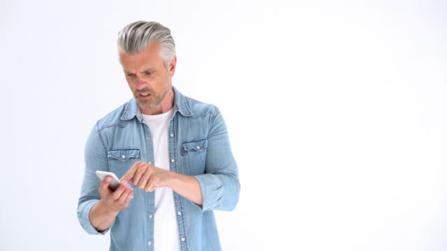 frustrated and angry man with his smartphone - displeased stock videos & royalty-free footage