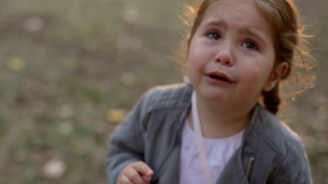 frustrated child crying in the park - crying stock videos & royalty-free footage