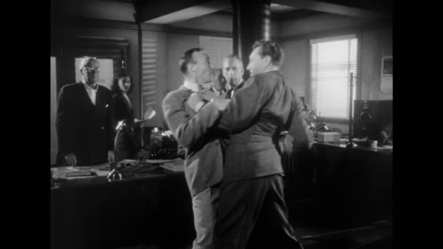 1948 frustrated employee punches bully boss before walking away - 辞職点の映像素材/bロール
