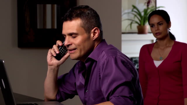 frustrated latin couple argue with company over the phone - debt stock videos & royalty-free footage