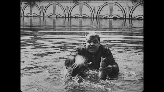 1917 frustrated man (fatty arbuckle) fights fish in water - fatty arbuckle stock videos and b-roll footage