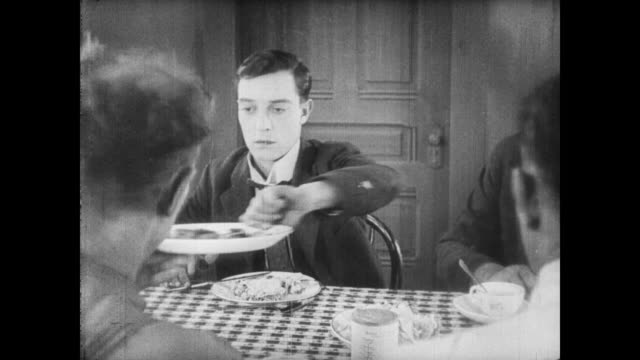 1922 A frustrated man (Buster Keaton) sits down to eat but spends his time passing food around the table instead