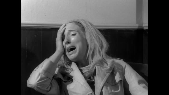 1968 frustrated man tells tearful woman to calm down as she recalls zombie attack - distressed stock-videos und b-roll-filmmaterial