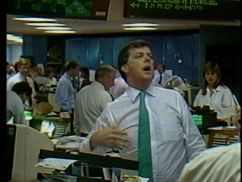 frustrated stock brokers in trading rooms in 1987. - stock trader stock videos & royalty-free footage