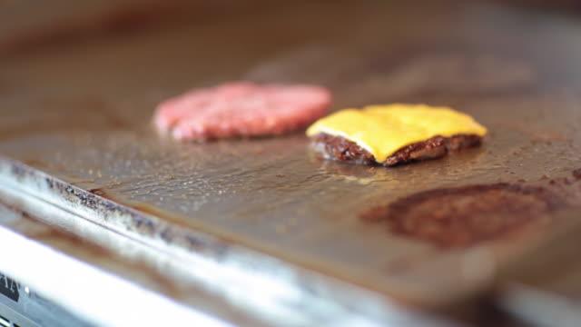 frying a cheeseburger - cheeseburger stock videos & royalty-free footage