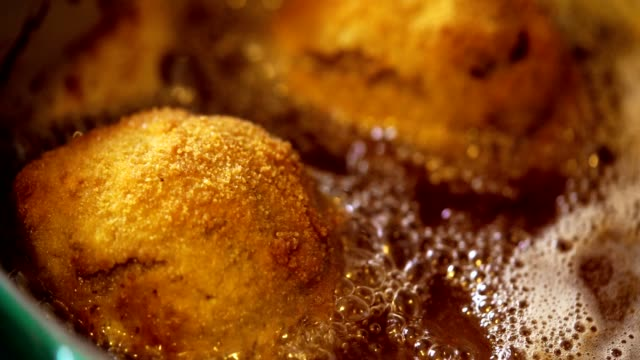 frying british scotch eggs in deep fry oil - scottish culture stock videos & royalty-free footage