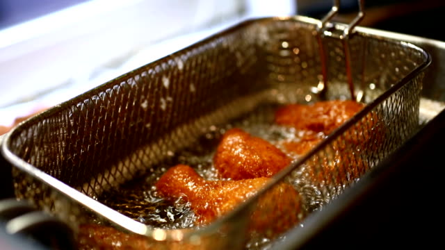 frying chicken in deep fryer. - unhealthy eating stock videos & royalty-free footage