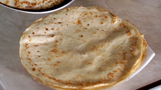 frying crepes - pancake stock videos & royalty-free footage