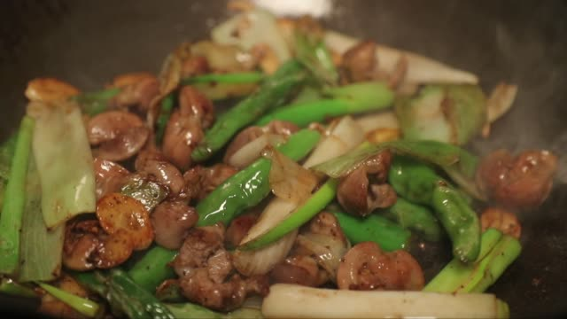 frying dakddongjip(chicken gizzards) with pepper and garlic - scallion stock videos & royalty-free footage
