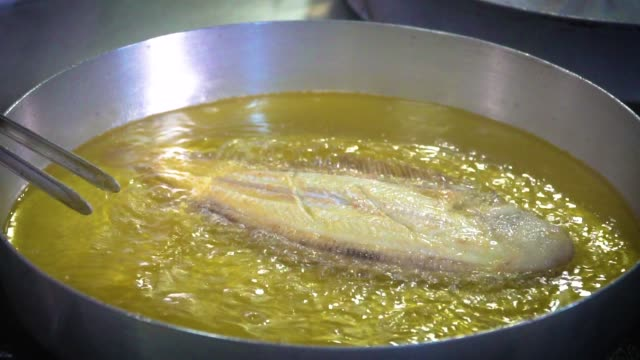 frying fish in big pan - fried stock videos & royalty-free footage