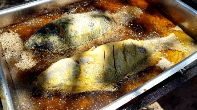 Frying fish outside