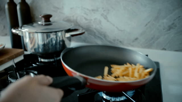 frying french fries - frying pan stock videos & royalty-free footage