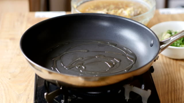 frying leek for making risotto - sunflower oil stock videos and b-roll footage