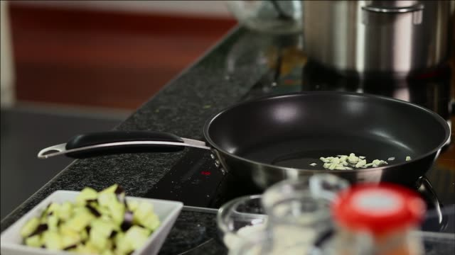 frying onion and garlic - garlic stock videos & royalty-free footage