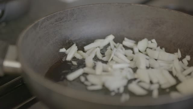 Frying onions panning shot