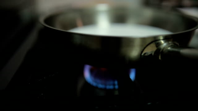 frying pan on stove in restaurant kitchen - hob stock videos & royalty-free footage