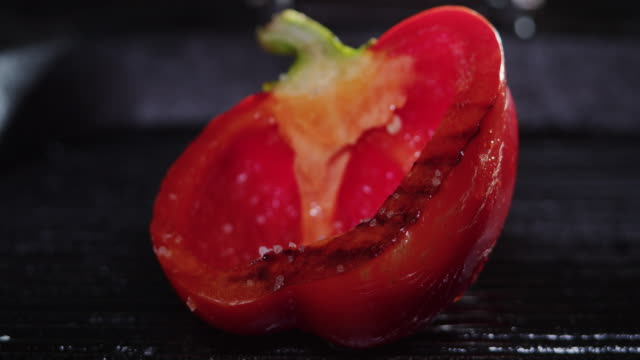 frying red bell pepper. adding salt. close-up - adding salt stock videos & royalty-free footage