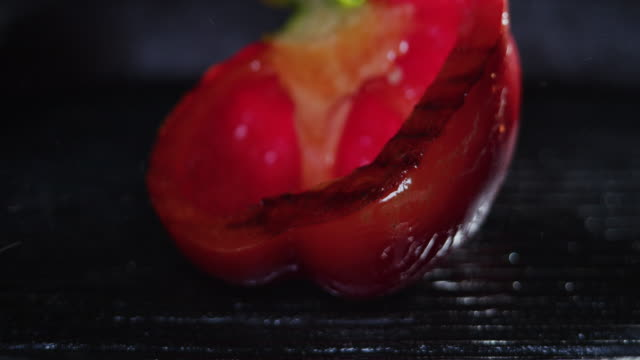 frying red bell pepper. close-up - red bell pepper stock videos & royalty-free footage