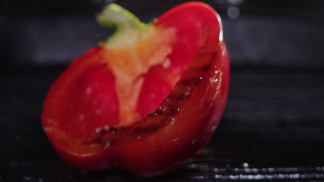 frying red bell pepper. rack focus. close-up - red bell pepper stock videos & royalty-free footage