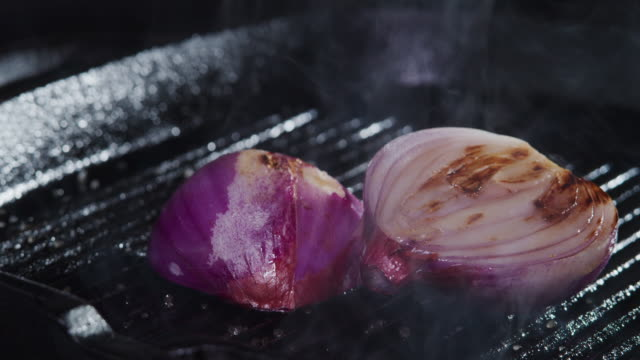 frying red onion. close-up - plant bulb stock videos & royalty-free footage