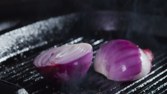 frying red onion. placing. close-up - plant bulb stock videos & royalty-free footage