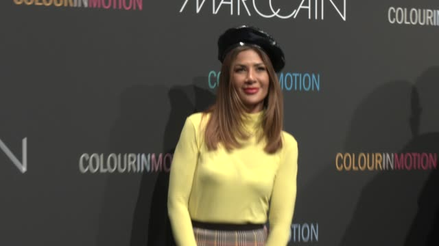 stockvideo's en b-roll-footage met füsun lindner is seen wearing total look marc cain black white two tone heels neon turtleneck plaid skirt bag beret at the marc cain fashion show... - coltrui