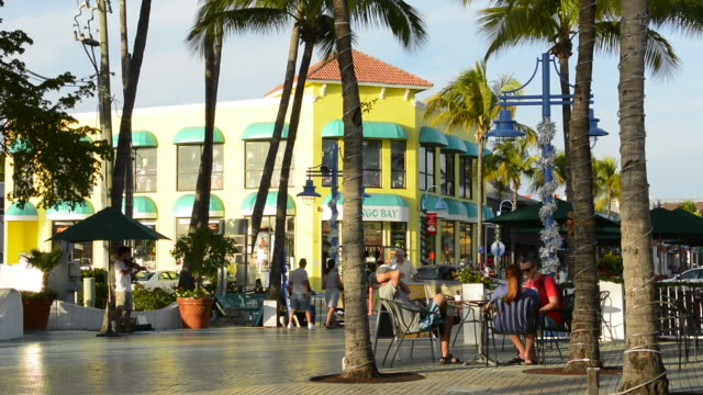 ft myers beach florida beach at famous pier with shops and colorful stores for holiday tourists vacation - fort myers beach stock videos & royalty-free footage